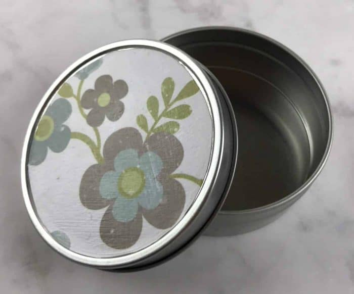 decorate a tin container using scrapbook paper and Modge Podge