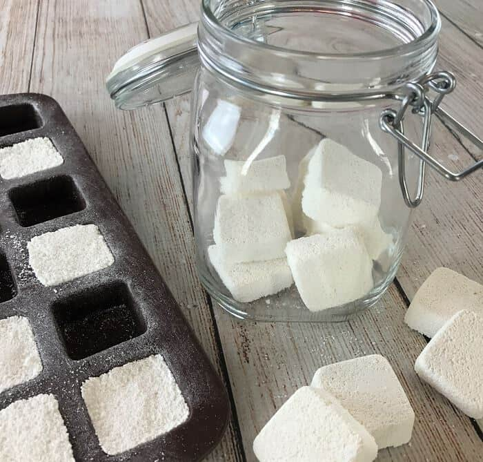 easy-to-make homemade natural dishwasher detergent tabs and they REALLY WORK! Cleans stuck-on food, gets silverware shiny, & glasses sparkling! DIY essential oil recipe for dishwasher detergent tabs. #essentialoils #essentialoilrecipes #essentialoilcleaning #naturalDIY #naturalcleaning #homemadedishwashertabs #essentialoilDIY #essentialoilsforkitchen #essentialoiltabs #easyDIY