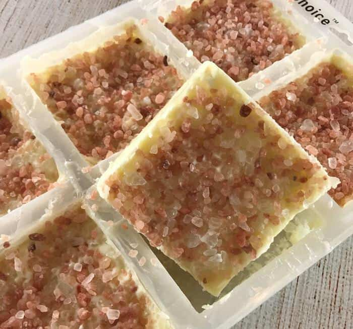 once salt scrub bars are completely cooled, remove them from silicone molds