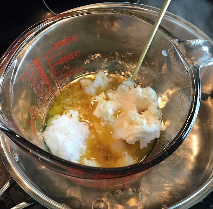 butters and oil being melted down in double boiler