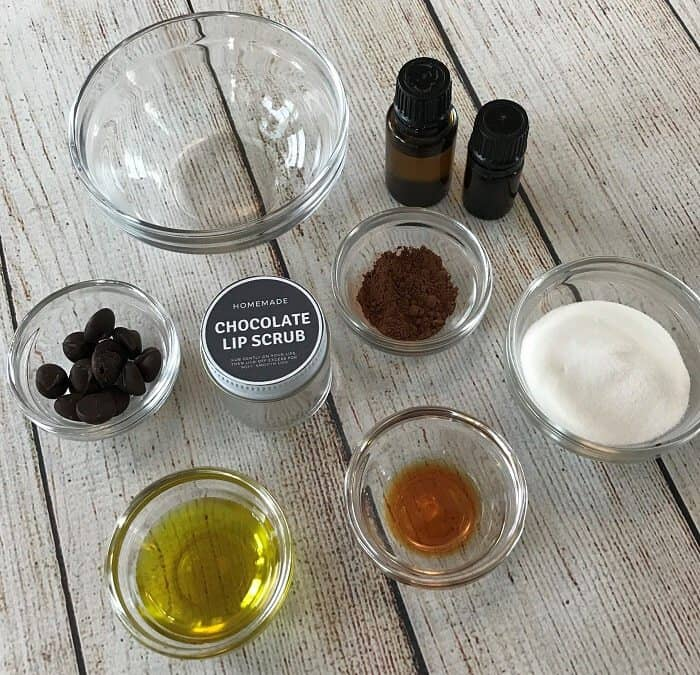 homemade chocolate lip scrub recipe with essential oils -- divine combination of chocolate & orange that's both hydrating and gently exfoliating, leaving you with soft, smooth, healthy lips. #essentialoils #essentialoilrecipes #lipscrub #sugarscrub #chocolatelipscrub #naturalDIY #naturalbeauty #lipscrubrecipes #essentialoilDIY #essentialoilGIFTS #DIYgifts #easyDIY
