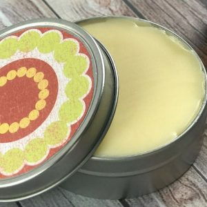 Upset stomach essential oil salve recipe for bloating, gas, constipation, indigestion, nausea, diarrhea, cramps, or motion sickness). This natural home remedy works both topically and aromatically to help calm and soothe tummy troubles. #essentialoils #essentialoilrecipe #naturalremedy #upsetstomach #homemade #DIYessentialoil
