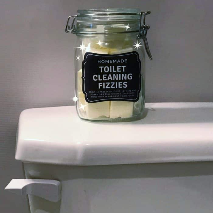 DIY Toilet Cleaning Fizzies with essential oil {aka toilet bombs) - cleans, freshens, scrubs, removes stains, deodorizes, and disinfects. made with lemon essential oil DIY natural toilet cleaner #toiletbomb #naturalDIY #toiletcleaner #bathroomcleaner #DIYessentialoil #essentialoilcleaning #lemonessentialoil