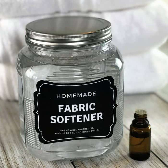 homemade fabric softener recipe made with essential oils- free printable label- This easy 2-ingredient natural, non-toxic homemade fabric softener is better than store-bought versions. It's cheap, easy to make, gets clothes cleaner than detergent alone, makes towels soft, fluffy & absorbent, helps prevent static cling and smells great! #essentialoils #doterra #yl #youngliving #diy #natural #printable #freeprintable -- essential oil recipe, natural cleaning