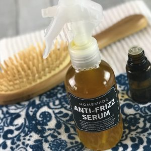 diy Anti-Frizz Serum {made with essential oils} - locks in moisture, nourishes, smooths hair, and controls frizz. Works great for dry hair, curly hair, and humid weather. (essential oil recipe, natural beauty, essential oils for hair, #DIY, #hair, #doTERRA, doTERRA, Plant Therapy, Young Living)
