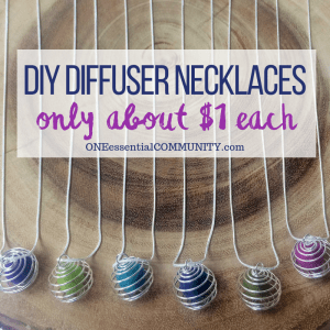 six homemade essential oil diffuser neckalces made with silver-plated snake chain, silver wire pendants, and wool felt balls in blue, green, turquoise, olive, and magenta