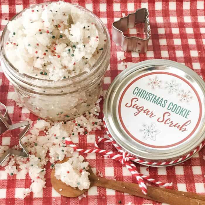 Christmas Cookie Sugar Scrub in jar, next to lid with custom label