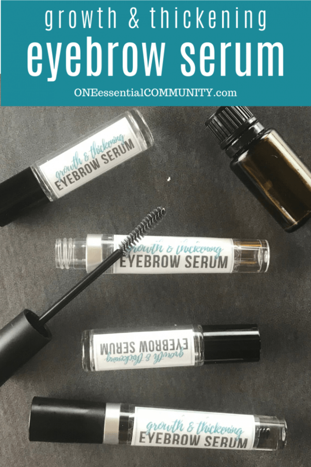 four DIY eyebrow growth serum containers on table with essential oil bottle