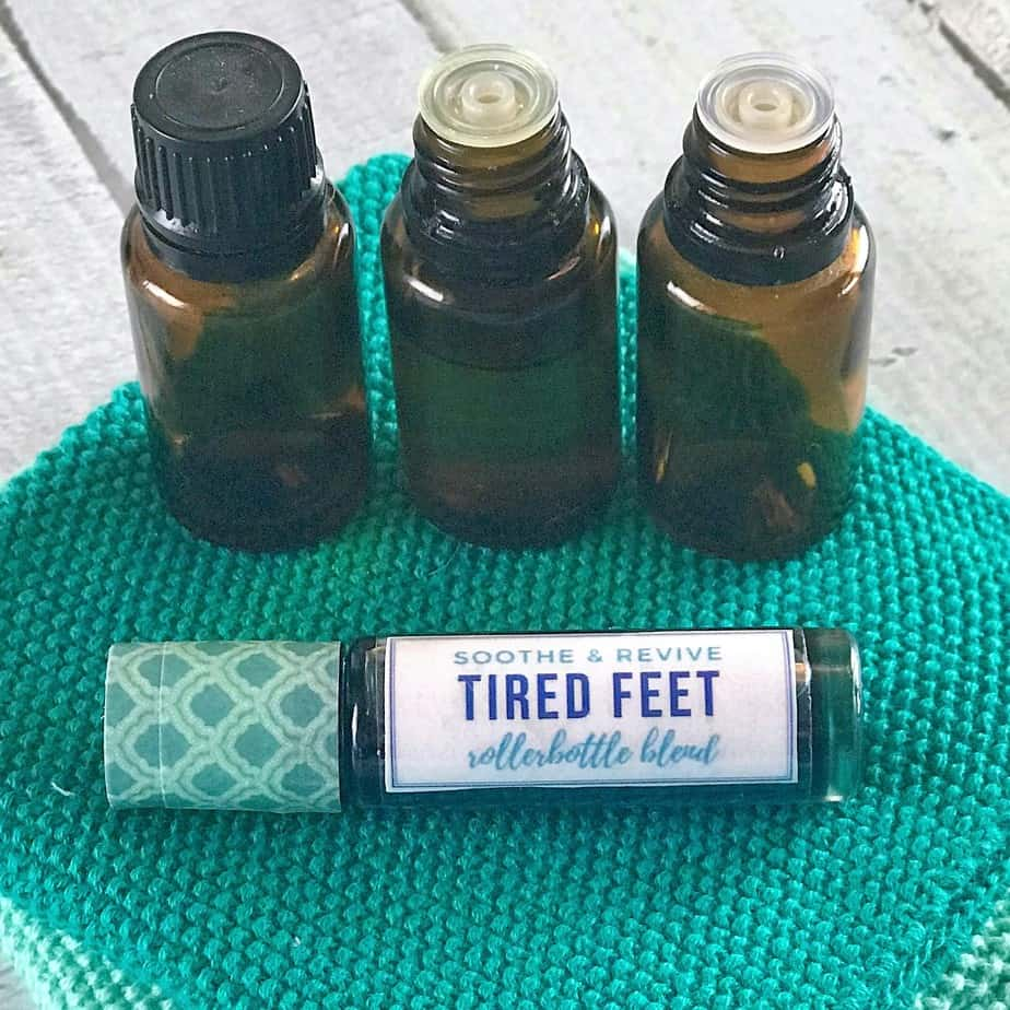 3 essential oil bottles and tired feet roller bottle