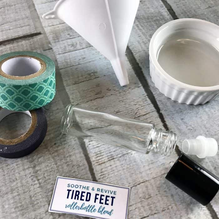 supplies for tired feet essential oil roller (10ml roller bottle, free printable label, small funnel, mini bowl with fractionated coconut oil)