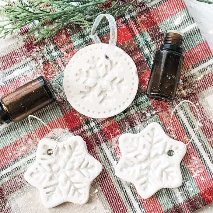 homemade salt dough christmas tree ornaments, adding ribbon or twine to them for hanging on Christmas tree