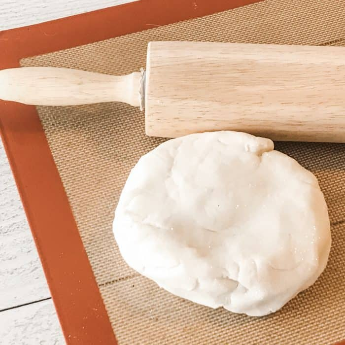 rolled out salt dough on silpat with rolling pin