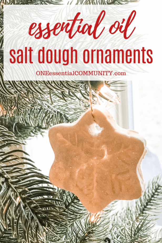 Essential Oil salt dough ornaments title image with snowflake-shaped ornament hanging from Christmas tree