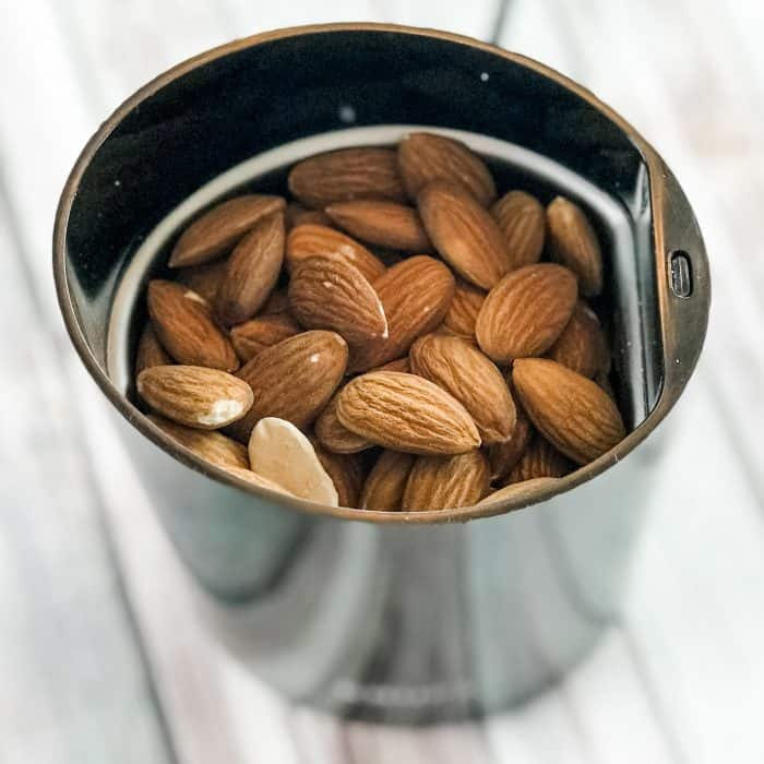 almonds, rice, and beans in metal jar, ready to grind into Lush Buffy Bar ingredient