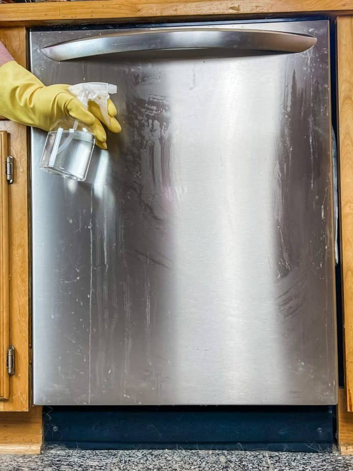 using homemade stainless steel polish (made with essential oils) to clean the front of dishwasher