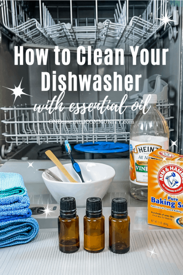 open dishwasher with cleaning supplies (essential oil, baking soda, vinegar)