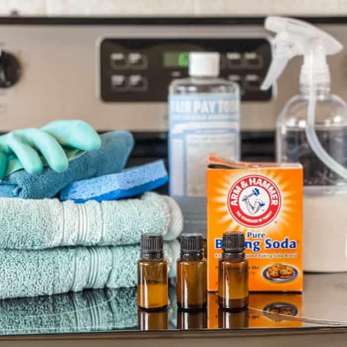 supplies used to naturally clean glass stovetop= towels, glove, sponge, essential oil, baking soda, Castile soap, and spray bottle