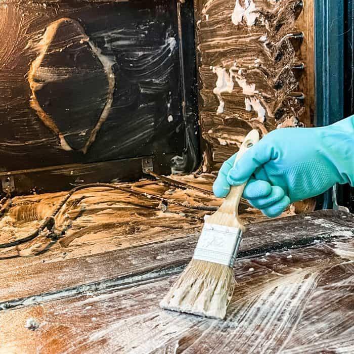 brush cleaning paste on oven door
