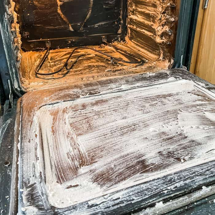 natural oven cleaner applied to oven walls, bottom, and door --allow it to work for 1 hour