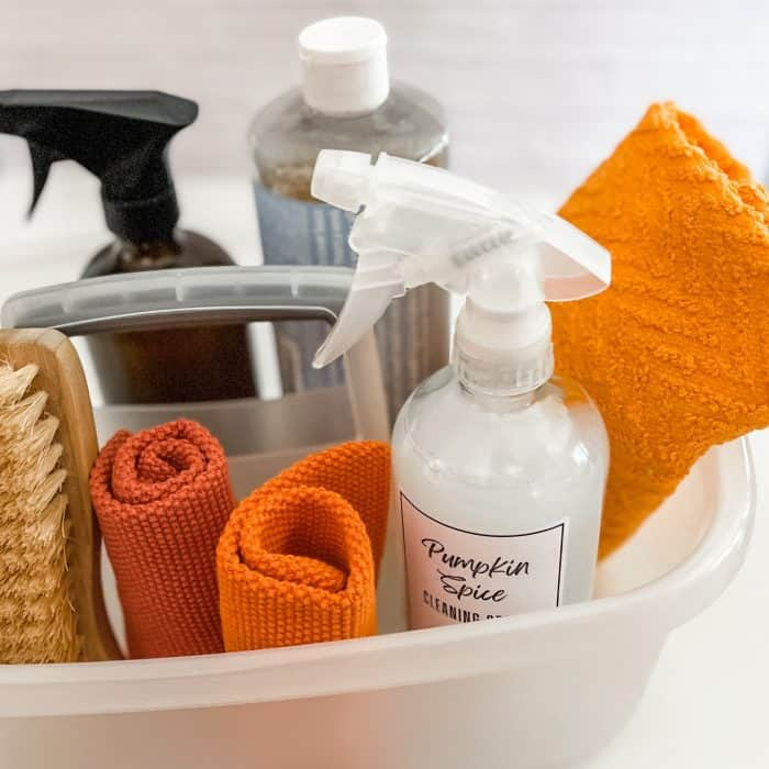 cleaning tote with pumpkin spice cleaner, Castile soap, natural scrub brush, and microfiber cloths