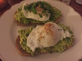 Poached eggs on avocado and bread