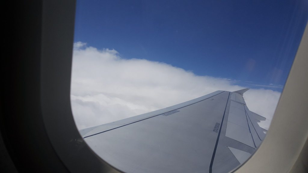 travelling with toddlers - view from an aeroplane window with the wing of the plane