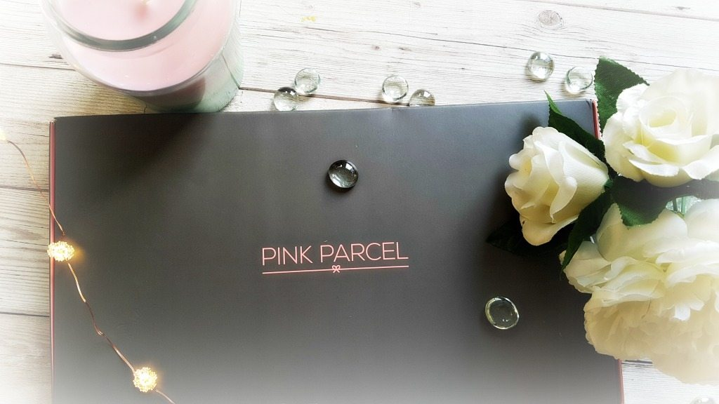 pink parcel subscription box with flowers candle and fairy lights