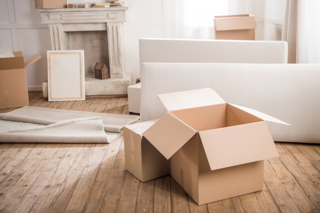 open cardboard boxes in an empty room
