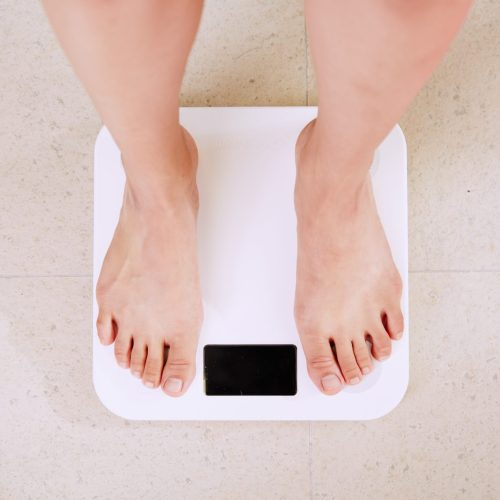 person standing on electronic scales