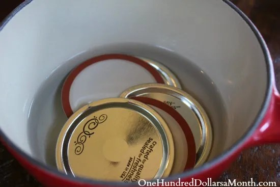 canning lids in pan