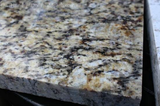 brown and black granite counter top