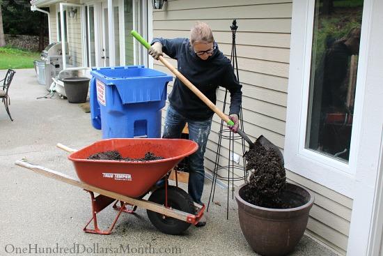 filling pots with potting soil
