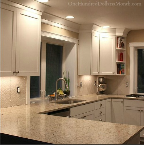 white kitchen cupboards and backsplash