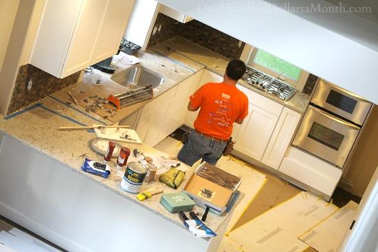 white kitchen cupboards dark floors dark backsplash