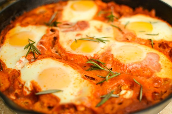 baked shakshuka with fennel and goat cheese in cast iron skillet