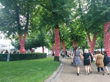 Trees wrapped with polka dotted fabric