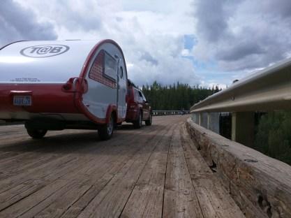 Wooden deck, curved bridge.