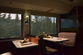 I'll have a nice dinner in the dining car. I missed breakfast because I was outdoors enjoying myself. I am seated at a two person booth like the one directly across the aisle.