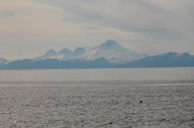 While I can't be certain I believe this is Iliamna Volcano, across Cook Inlet
