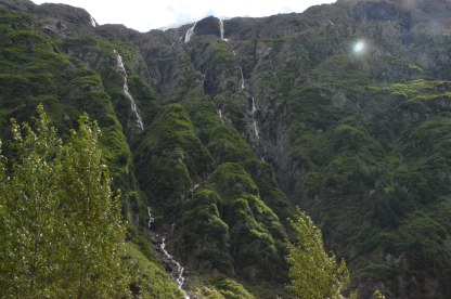 Waterfalls have carved deeply into this hillside, take note of the waterfall center top.