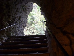 Stairway tunnel carved through the rock to start the walk.