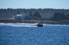 Fishing boat heading in, passing the Mark Island Lighthouse