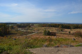 """Looking from Little Round Top (Union Line) towards the Southern Line. The rocks are """"devils den"""""""
