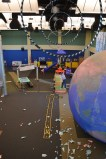 Back at the science center, fly your paper airplane through the hoops, or land on the runway, etc.