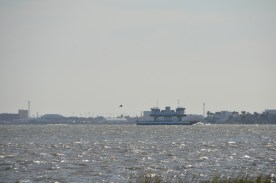 Ferry as seen from the waiting line. Notice the water plowing up from the bow (right) - also note the pelican.