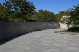 MLK Jr, the wall has quotes, the statue and rocks are in the center and this wall extends on both sides.