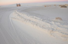 Plowed roadside, as the sun sets. Looks almost like plowed snow.