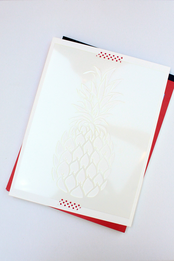 tape the pineapple stencil to the paper so it doesn't move
