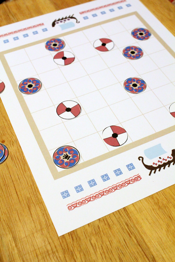 """Tafl game board with the king """"safe"""" in the corner"""