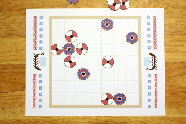 Tafl game board with the king surrounded